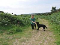 Julie and her dog Maisie on the Pebblebed Heaths